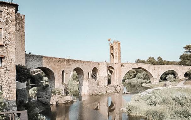 girona bridge blue skies water rock columns