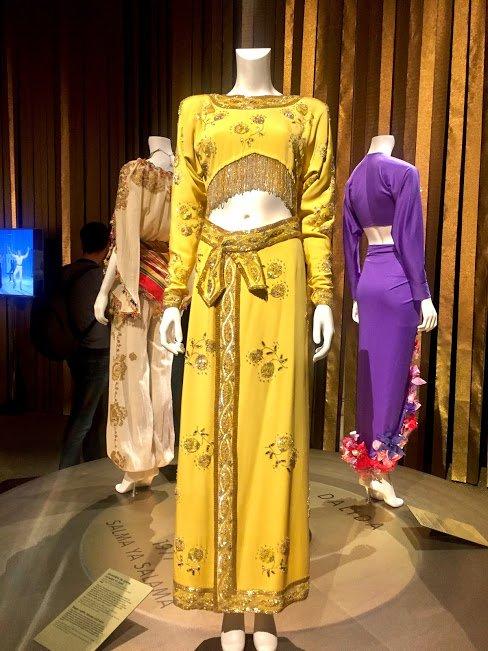 purple yellow dresses mannequins