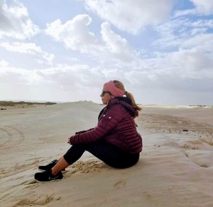 girl sitting on sand dune Perth, Australia